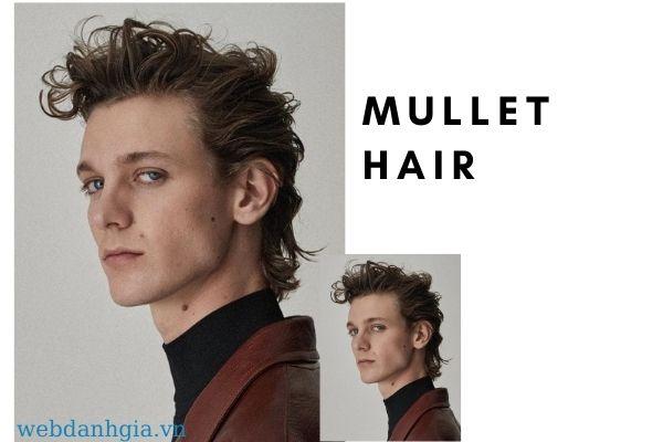 Kiểu tóc mullet nam dài xoăn nhẹ.